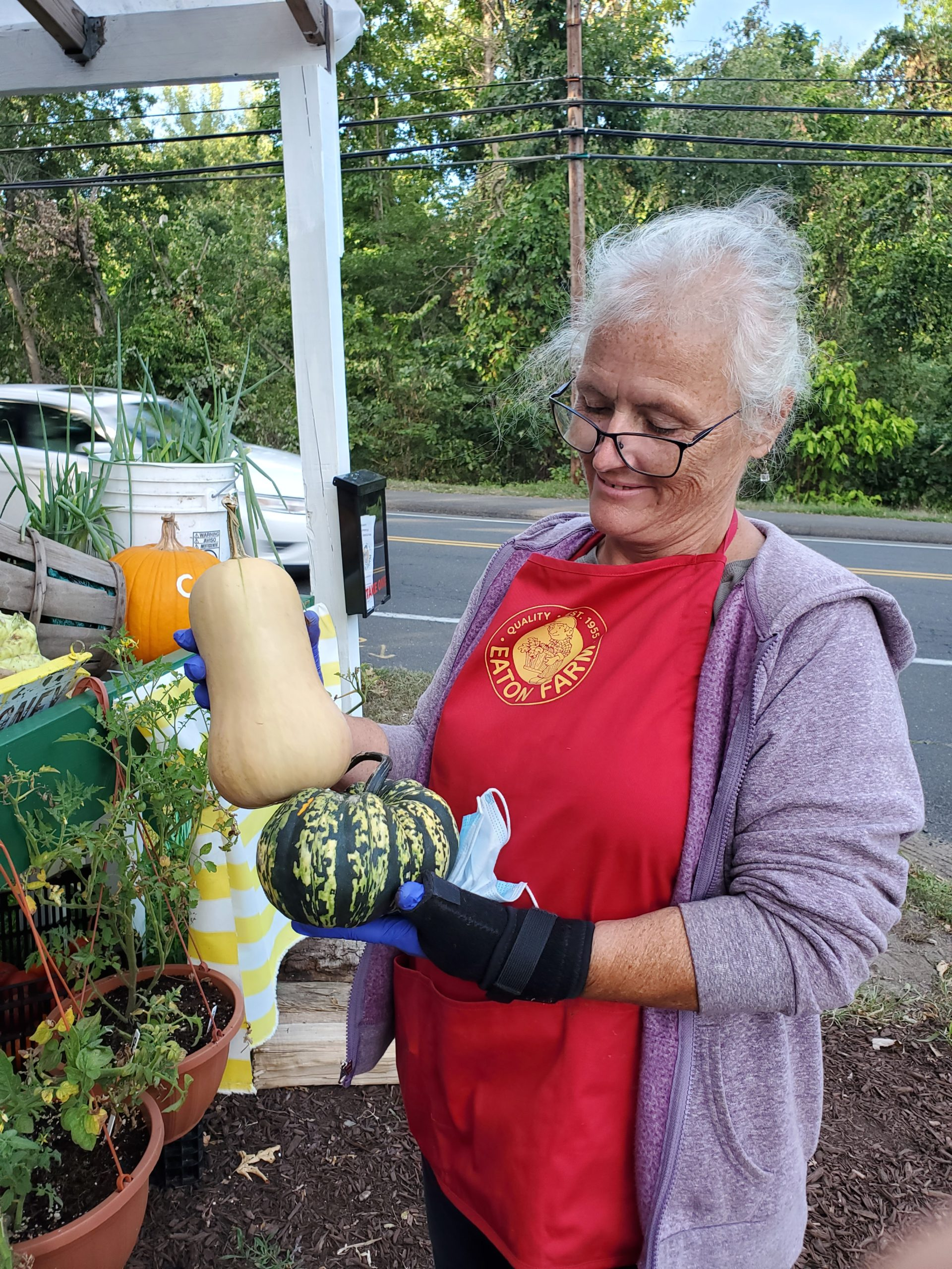 Farm manager Karin with Carnival and Butternut Squash